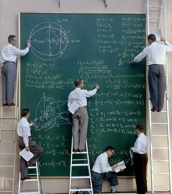 NASA scientists with their board of calculations, 1961 CROPPED